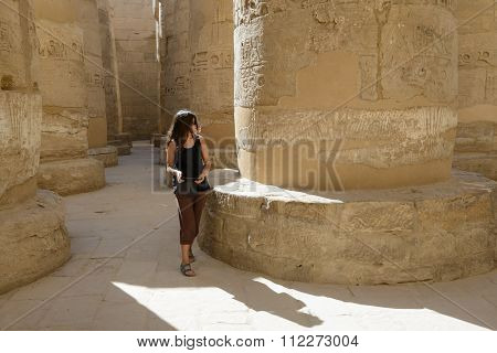 Woman Among Old Stone Column