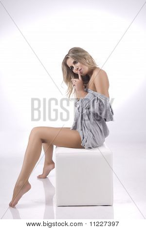 The naked model on a gray background
