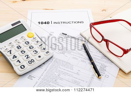 Income Tax Income Return Form With Pen And Calculator