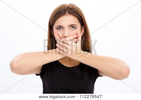 Sad depressed young woman covered her mouth with both hands over white background
