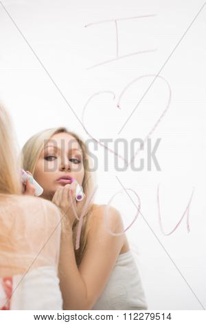 beautiful girl written on a mirror in lipstick, I love you. and lipstick