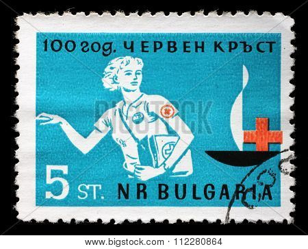 BULGARIA - CIRCA 1963: A stamp printed in Bulgaria devoted to 100 anniversary of the Red Cross shows a woman doctor, circa 1963