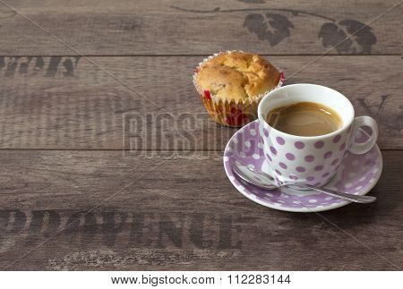 A cup of Coffee and apple muffin on a wood background
