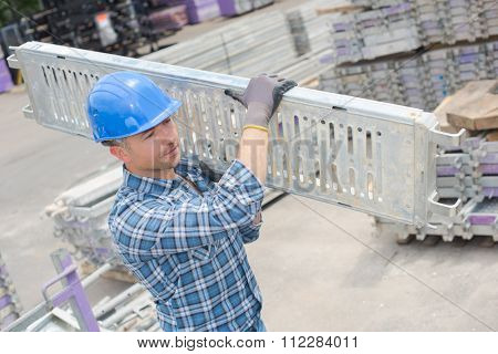 working carrying a solid beam