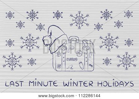 Luggage With Santa Hat And Snowflakes, With Text Last Minute Winter Holidays