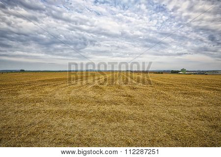 Hdr Of An Harvested Field With Cloudscape In Summer