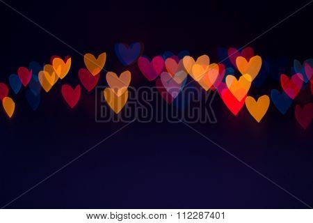 Line Of Colorful Blurred Heart Shape Lights