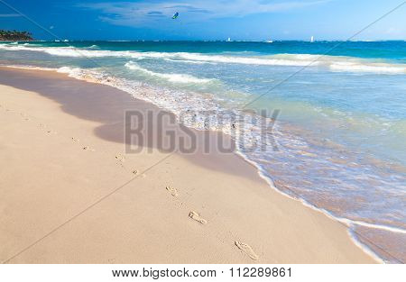 Empty Sandy Beach With Footsteps In Sand