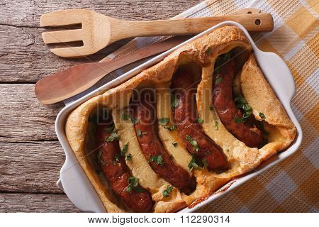 Sausage Baked In Pastry In A Dish Close Up. Horizontal Top View