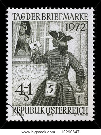 AUSTRIA - CIRCA 1972: A stamp from Austria illustrating Day of Post Stamp. The postman brought the lady a letter, circa 1972.