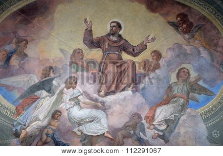 LJUBLJANA, SLOVENIA - JUNE 30: Saint Francis of Assisi surrounded by angels, fresco in the Franciscan Church of the Annunciation in Ljubljana, Slovenia on June 30, 2015