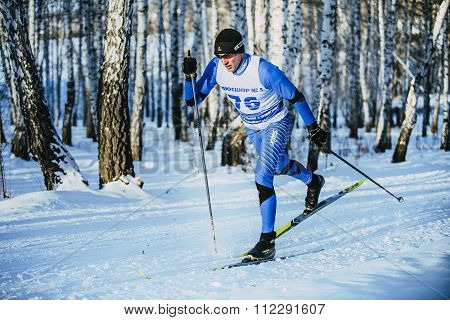 closeup young athlete skier during race in woods classical style