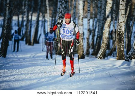 rivalry young athlete skiers race in winter forest classic style