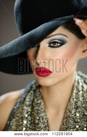 Beautiful female model with makeup wearing a hat