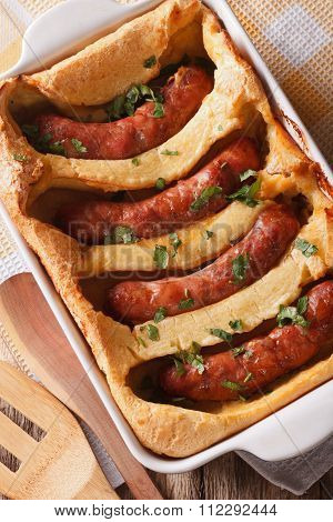 Traditional English Dishes Toad In The Hole Close-up Vertical Top View