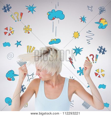 Angry woman shaking her head against grey background