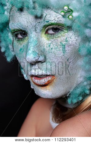 Portrait beautiful woman with creative makeup. Face mask of clay, looking like a statue