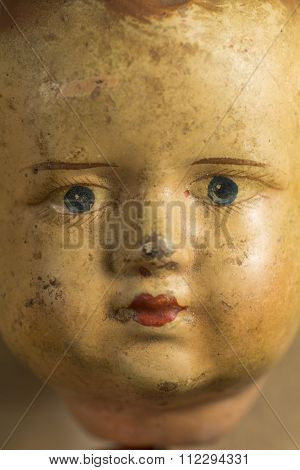 Face of an antique doll Celluloid