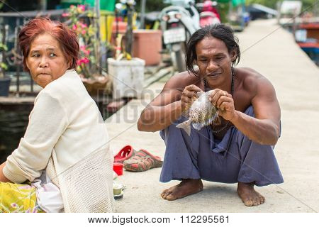 KOH CHANG - THAILAND - DEC 22, 2015: Unidentified locals in fisherman's village of the island. Island is on Gulf of Thailand, near border with Cambodia, population of 5356 people living in 8 villages.