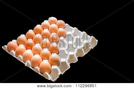 Eggs In Package Isolated On Black Background
