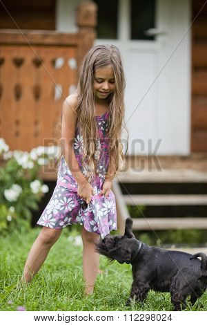 Little Girl Playing With Her Dog
