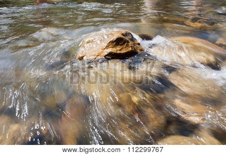 Water Stream In High Mountains
