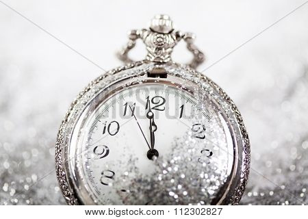 New Year's at midnight - Old clock with stars, snowflakes and holiday lights