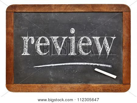review word in white chalk on a vintage slate blackboard