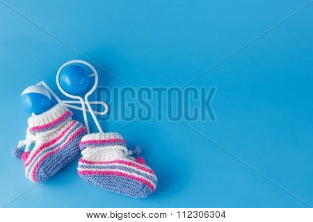 Rattle And Knitted Booties For The Newborn