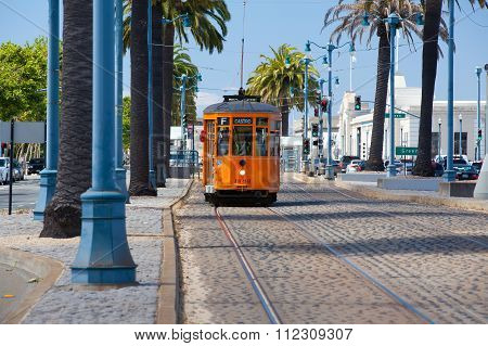 Typical San Francisco Train Traveling Down The Embarcadero On A Sunny Day.