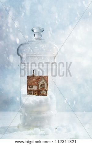 Snow globe with country cottage