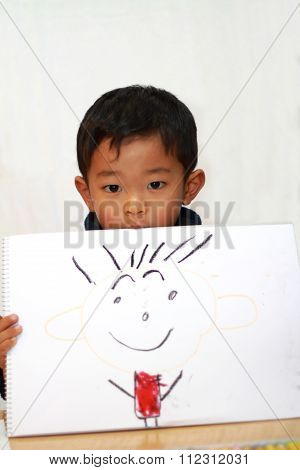 Japanese boy with father's portrait (4 years old)