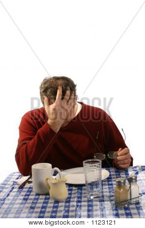 Unhappy Man In Diner