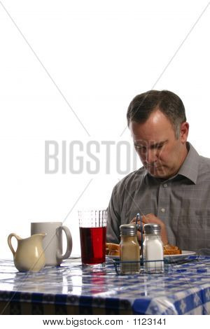 Man Praying In Diner