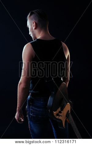 Young man  with electric guitar close up