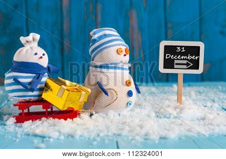 December 31 calendar day written on roadsign. Two snowman with gift, New Year concept