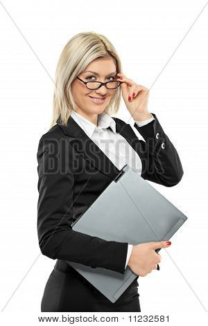 A Portrait Of A Beautiful Businesswoman Holding A Laptop