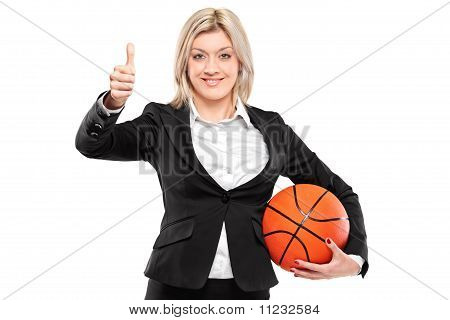 A Happy Businesswoman Holding A Basketball And Giving Thumbs Up