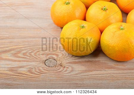 Mandarin On Wooden Background