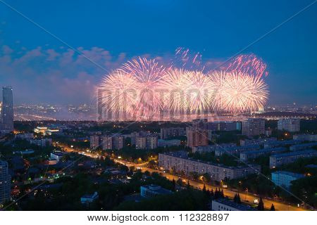 panoramic view of residential area of city with fireworks during celebration of Victory Day