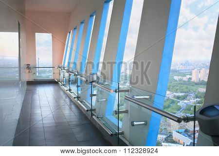 interior viewing platform high-rise building with windows railing evening