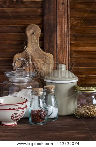 Kitchen Still Life. Olive Chopping Board, Glass Jar With Flour, Vintage Utensils - Bowl, Cup, Pot An