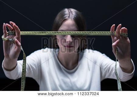 Anorexic Female With Tape Measure