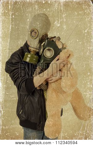 Child With Toy In Gas Mask. Grunge Effect.