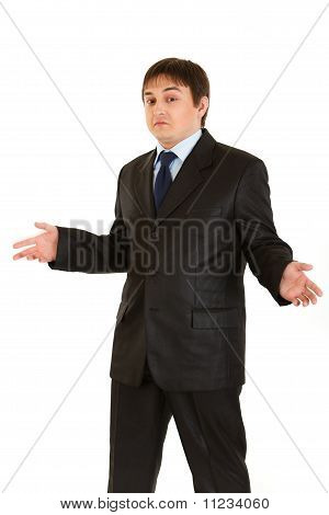 Young businessman with surprise expression on his face isolated on white