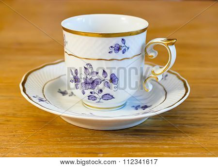 white porcelain cup with a pattern