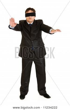 Disoriented businessman with blindfold covering his eyes isolated on white