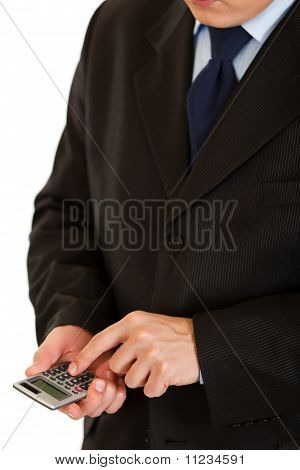 Businessman using calculator. Symbol of business and finance. Closeup