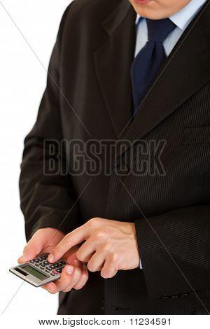 Businessman using calculator. Symbol of business and finance. Closeup