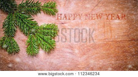 Christmas Green Spruce Twig On Wooden Old Rustic Background.